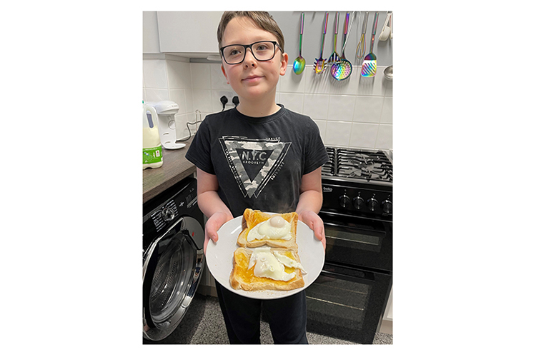 Student with poached eggs
